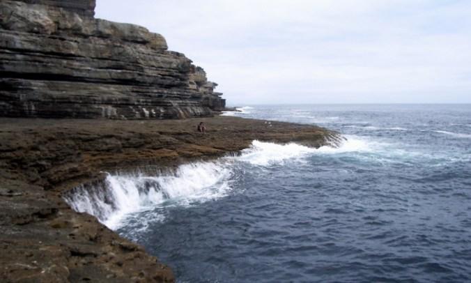 the ocean embraces the shoreline