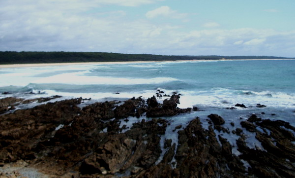 to the north, the cliffs and headlands of the Eurobodalla National park, with Tuross in the distance